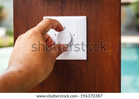Hand turn on switch - stock photo