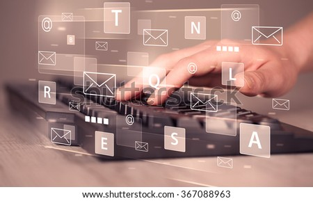 Hand typing on keyboard with digital tech icons and symbols - stock photo