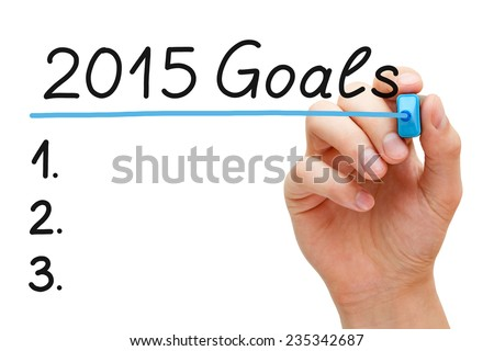 Hand underlining 2015 Goals with blue marker isolated on white.  - stock photo