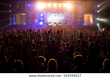 Hand up at the disco concert  - stock photo