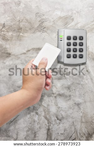 hand use key card  for Security entrance pad  - stock photo