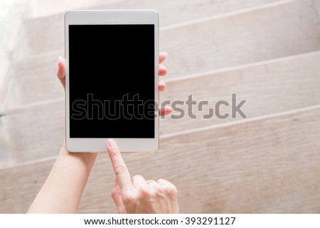 hand using tablet on top view. Clipping path included. - stock photo