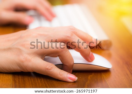 Hand usinging keyboard and mouse in office work place. Vintage filter. - stock photo