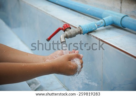Hand Wash from faucet - stock photo