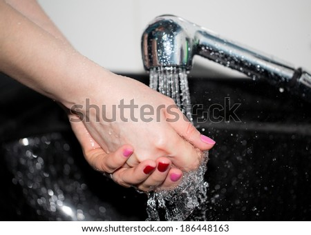 hand washing with tap water - stock photo