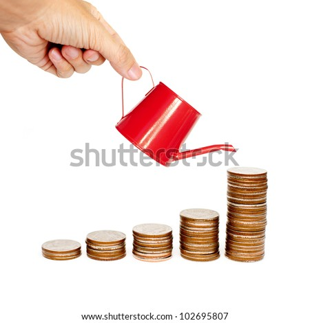 hand watering the rising coins - stock photo