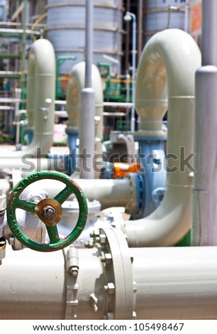 hand wheel for open valve in petrochemical plant - stock photo