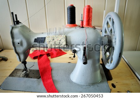 hand wheel old sewing machine. horizontal format - stock photo