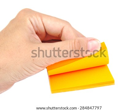 Hand with a block of yellow post it notes or notepapers on white background - stock photo