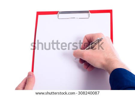 hand with a polished pen is writing at a clipboard - stock photo