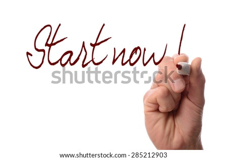 Hand with a red pen writing Start now! on a glass background - stock photo