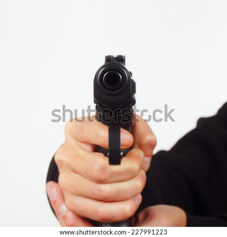 Hand with a semi-automatic gun pointing forward close up - stock photo