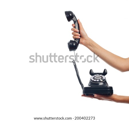 hand with a vintage phone - stock photo