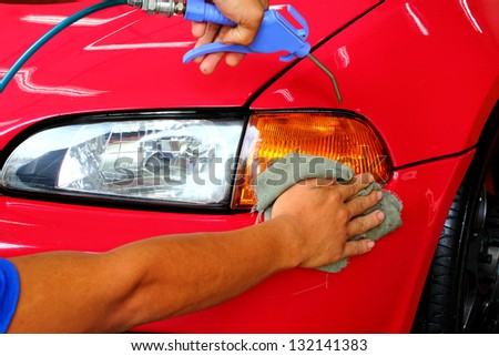 Hand with a wipe the car polishing - stock photo