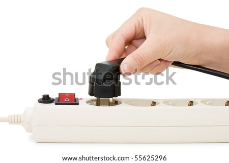 hand with an electric plug and socket is isolated over white - stock photo
