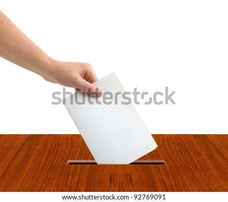 Hand with ballot and box isolated on white background - stock photo