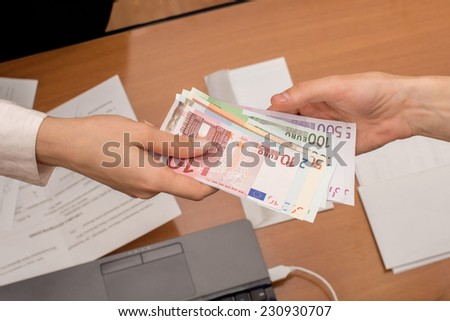 Hand with banknotes euro - stock photo