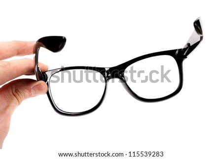 hand with black glasses isolated on white - stock photo