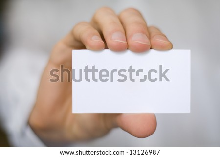 hand with blank white card - stock photo
