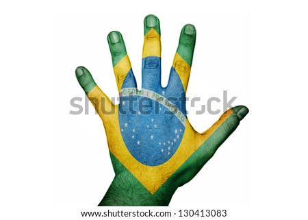 hand with Brazil flag - stock photo