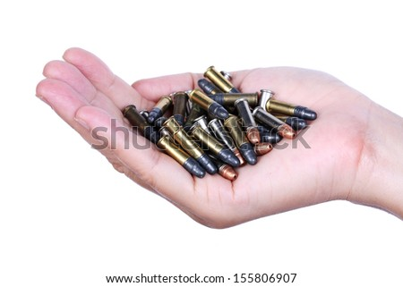 hand with .22 bullet isolated on white background. - stock photo