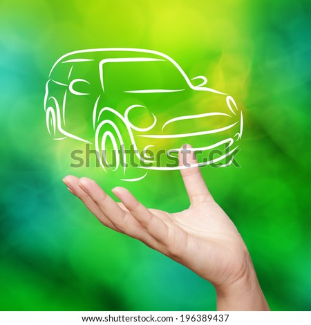Hand with car against green nature sky background as concept - stock photo