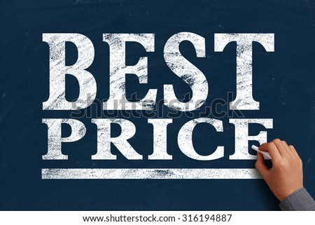 Hand with chalk is writing the text Best Price on the blue chalkboard. - stock photo