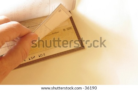 hand with checkbook on white background - stock photo