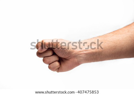 Hand with clenched a fist - stock photo