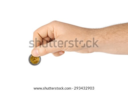 Hand with coin isolated on white background - stock photo