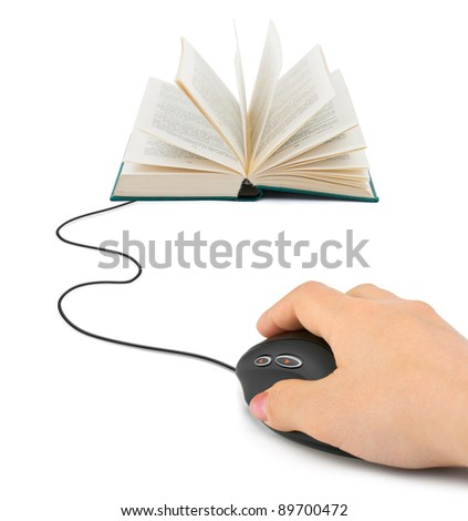 Hand with computer mouse and book - technology concept - stock photo