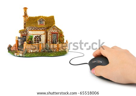 Hand with computer mouse and house isolated on white background - stock photo