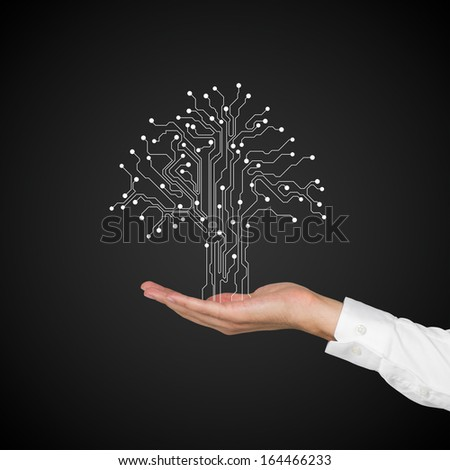 Hand with computer tree. - stock photo