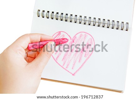 Hand with crayon drawing heart on white - stock photo