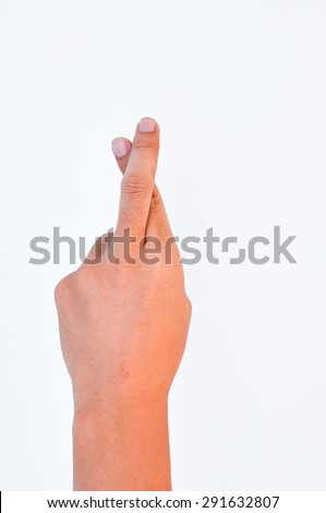 Hand with crossed fingers,  symbol fingers crossed human hand on white  - stock photo
