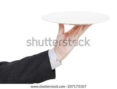 hand with empty flat white plate isolated on white background - stock photo