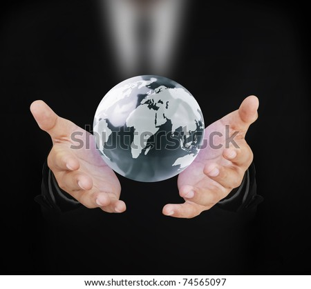 hand with globe - stock photo