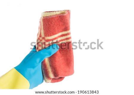 Hand with glove and a cloth cleans dust - stock photo