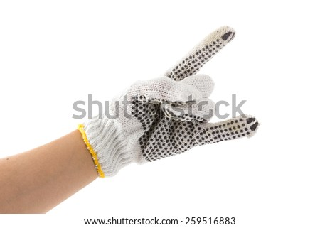 hand with glove is rock sign on white background - stock photo