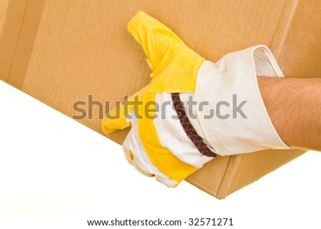 Hand with gloves holding a cardboard box - stock photo