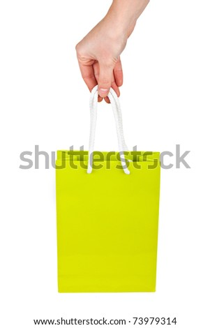 Hand with green bag isolated on white background - stock photo