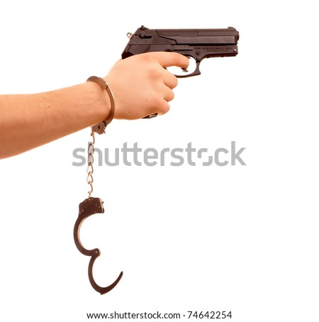 hand with gun and handcuff isolated on white background - stock photo