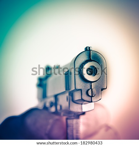 hand with gun isolated on white - stock photo