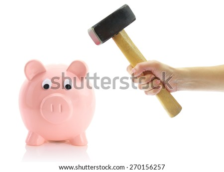 Hand with hammer and piggy bank, isolated on white - stock photo