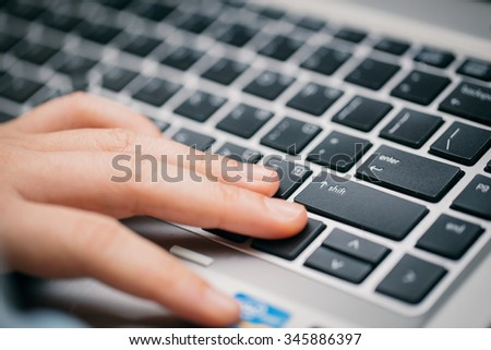 Hand with keyboard. - stock photo