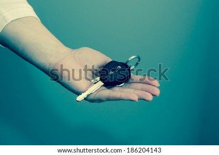 hand with keys on white background - stock photo
