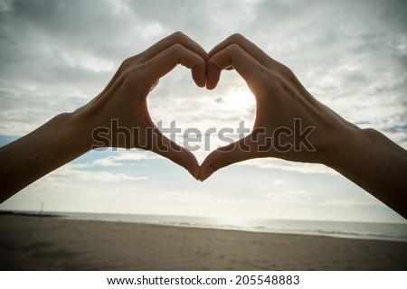Hand with love symbol - stock photo