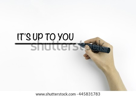 Hand with marker writing: It's Up To You - stock photo