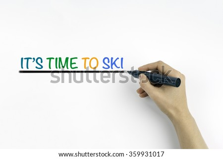 Hand with marker writing: Its Time To Ski  - stock photo