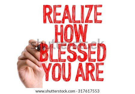 Hand with marker writing: Realize How Blessed You Are - stock photo